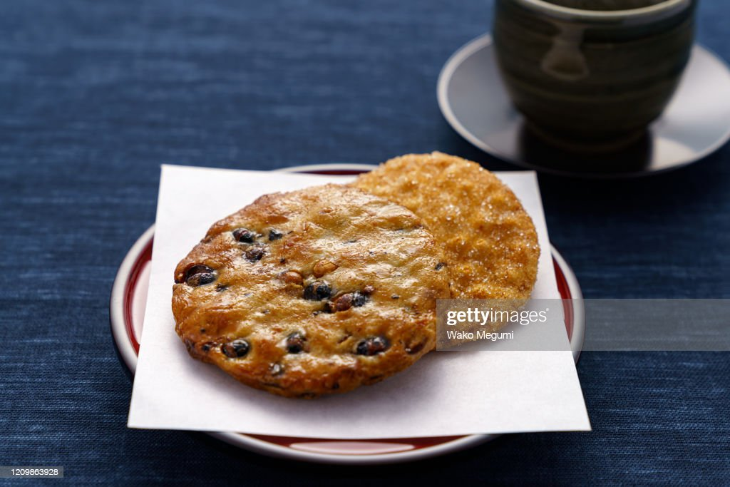 Japanese traditional confection rice crackers and hot japanese tea : Stock Photo