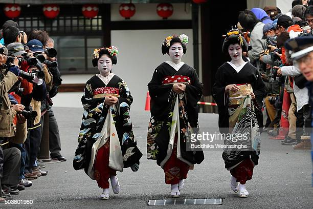 Japanese traditional female dancers maikos and performers geikos leave after attending the new year's ceremony at the Gion Kobu Kaburenjo Theater on...