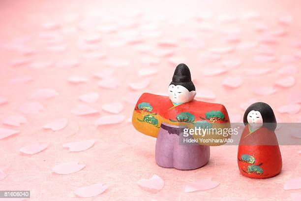 japanese traditional figurines with sakura petals - hinamatsuri stock pictures, royalty-free photos & images
