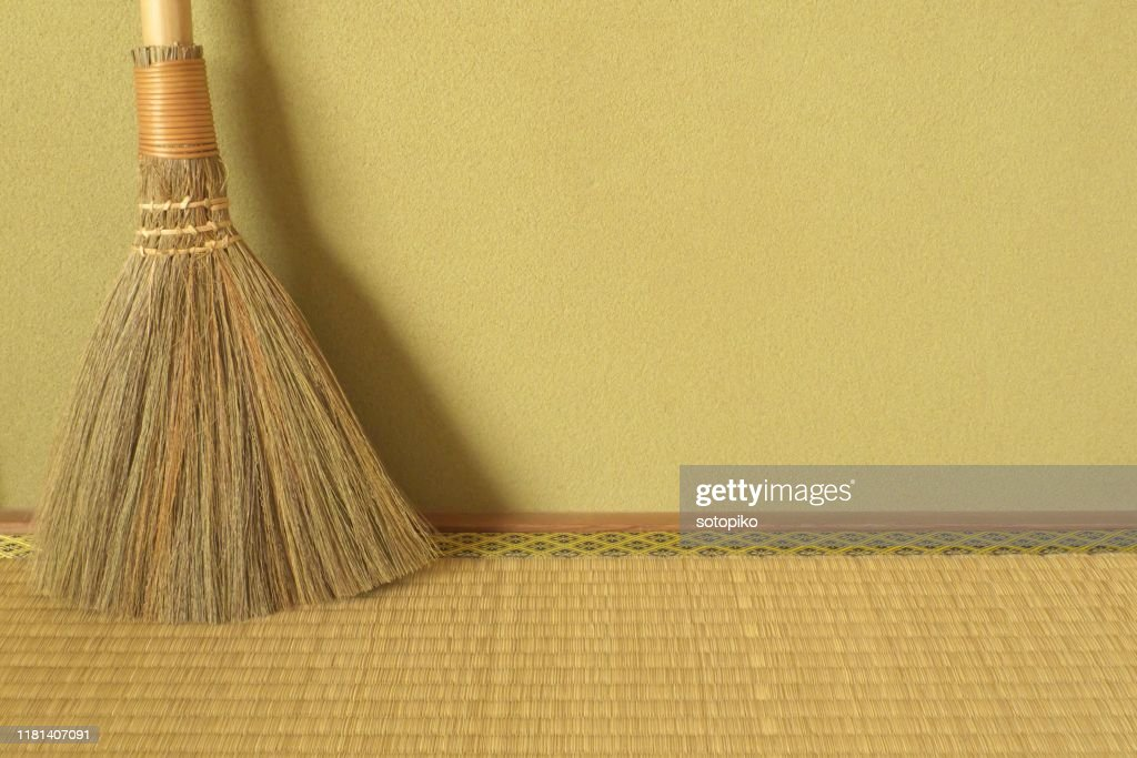 Japanese traditional mud wall, tatami matting and broom : Stock Photo