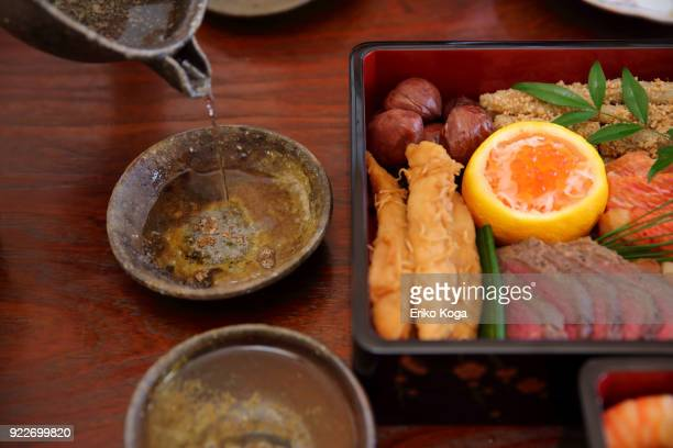 Japanese traditional New year's food called Osechi and sake