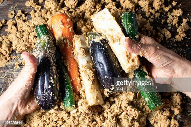 Japanese traditional pickles. Nukazuke of eggplant and a cucumber and a Japanese radish and the carrot. It is the Japanese grandmother's hand that has pickles.