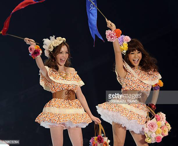 Japanese transsexual TV personality Ai Haruna and model Rina Fujii display creations from the Heather spring/summer collection during the Tokyo Girls...