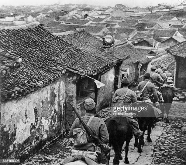 Japanese troops enter Manchuria on horseback during their 1931 invasion of the Chinese province