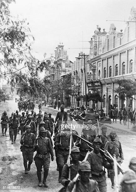 Japanese troops enter the Chinese city of Kaifeng on their way to Zhengzhou, both cities along the Yellow River, during Japan's long invasion of...