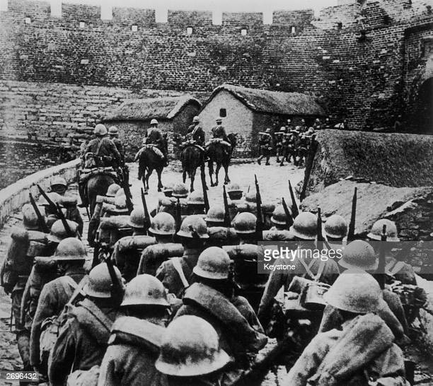Japanese troops entering Manchuria in the wake of the so-called Mukden Incident during the Sino-Japanese War. After a bomb of unknown origin damaged...