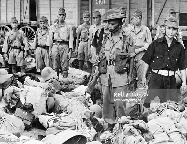 Japanese Troops Leave Bangkok One of the Gurkha sentries posted to oversee disarmed Japanese soldiers as they wait to board trains that will carry...