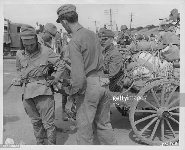 Japanese troops surrendering to US soldiers during World War Two Korea 1945