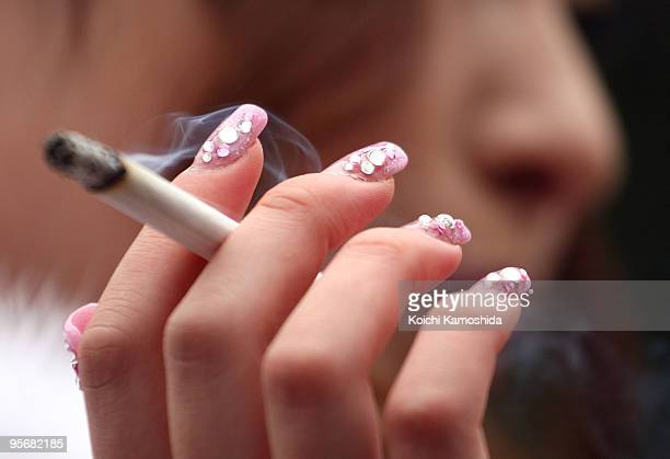 Japanese twentyyearold woman enjoys a cigarette during the annual ComingofAge Day ceremony at Toshimaen Amusement Park on January 11 2010 in Tokyo...