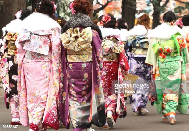 Japanese twentyyearold women dressed in traditional kimonos attend the annual ComingofAge Day ceremony at Toshimaen Amusement Park on January 11 2010...
