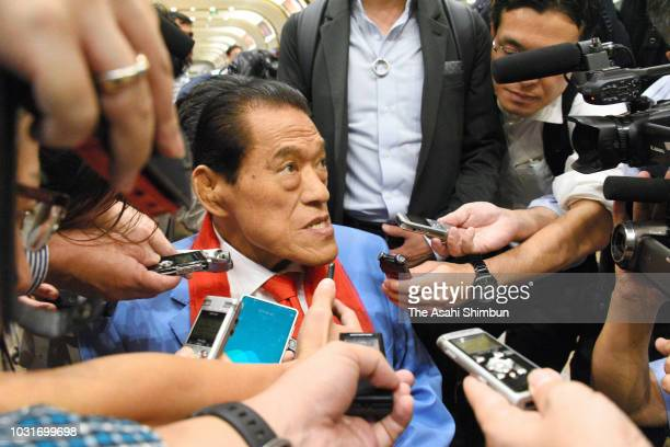 Japanese Upper House lawmaker Kanji Inoki aka Antonio Inoki speaks to media reporters on arrival at Beijing International Airport after attending...