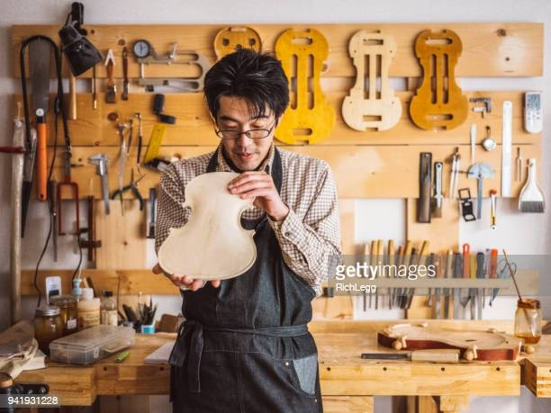 japanese violin maker - instrument maker stock photos and pictures