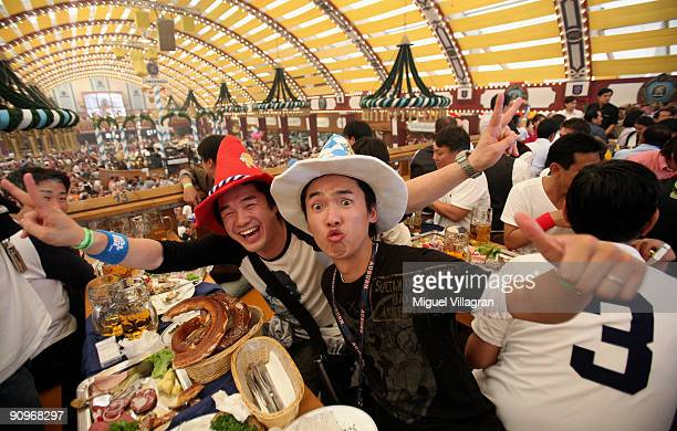 Japanese visitors of the Lowenbraeu beer tent pose for a picture on September 19 2009 in Munich Germany Oktoberfest is Germany's and the world...