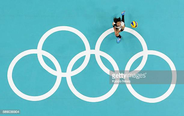Japanese volleyball player Yuki Ishii attempts to return the ball in the second set of a women's volleyball preliminary round match against Russia at...