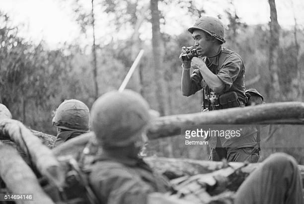 Japanese war photographer Kyoichi Sawada takes photographs at Hill 875 in Dak To Vietnam during fierce fighting in the area | Location Dak To Vietnam