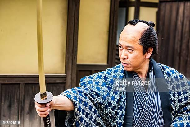 Japanese Warrior Drawing His Samurai Sword Katana