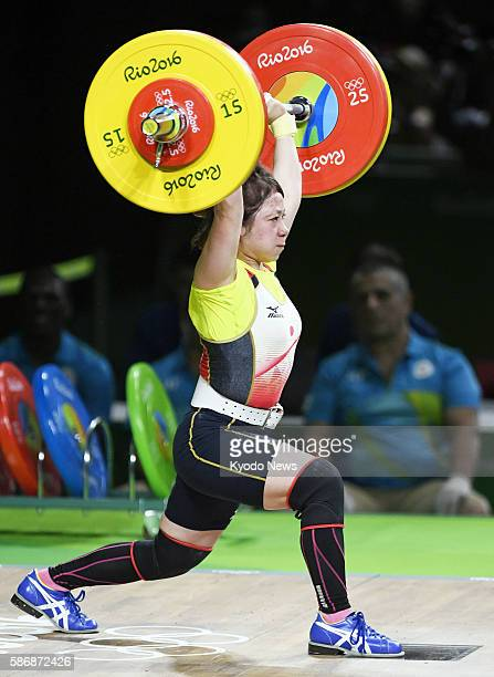 Japanese weightlifter Hiromi Miyake competes in the women's 48-kilogram event at the Rio de Janeiro Olympics on Aug. 6, 2016. Miyake, who lifted a...