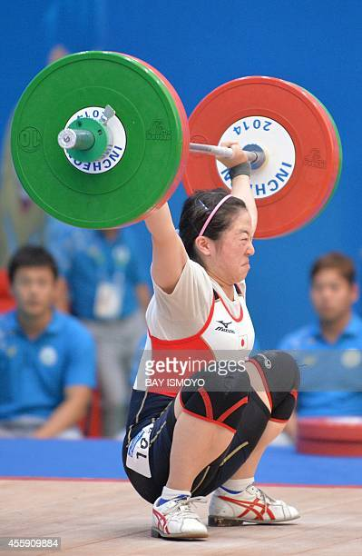 Japanese weightlifter Mikiko Andoh competes during the women's 58kg group A at the Moonlight Festival Garden Weightlifting Venue during the 2014...