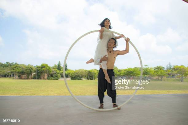 japanese who enjoys cyrwheel and competition. - acrobatic activity stock pictures, royalty-free photos & images