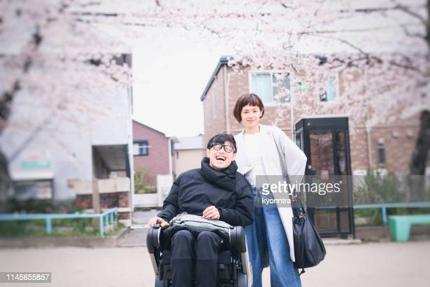 japanese wife and husband on the wheelchair - als stock photos and pictures