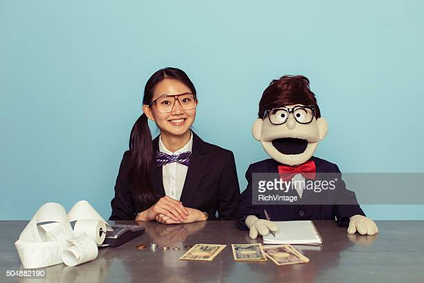 Japanese Woman Accountant and Puppet Associate
