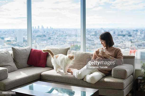 Japanese woman and cat in high-rise apartment
