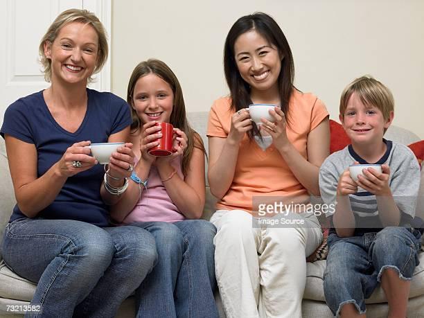 Japanese woman and English family having tea