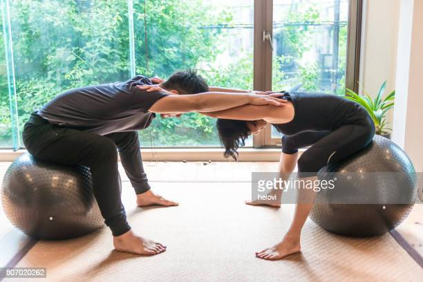 japanese woman and man doing yoga - man with big balls stock photos and pictures