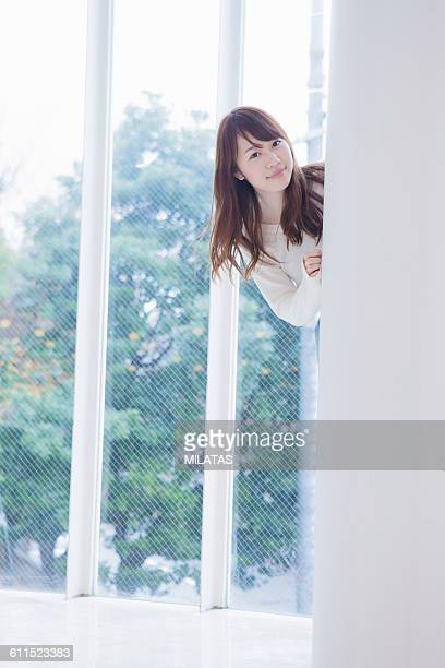 Japanese woman are seeing from the wall.
