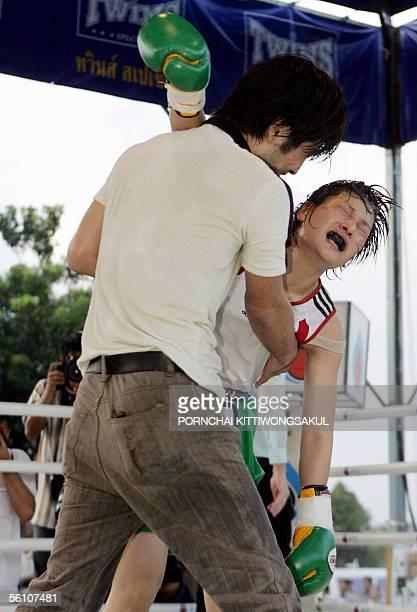 Japanese woman boxer Nanako Kikuchi celebrates with her trainer after winning the WBC Strawweight Women World Boxing Championship at the Thai...