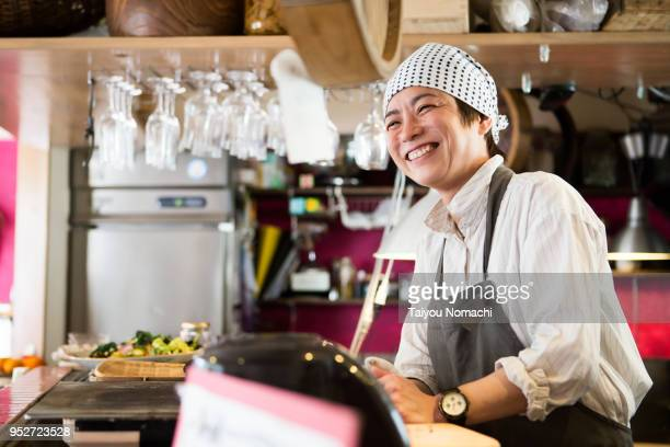 Japanese woman chef who shows a smile in the kitchen