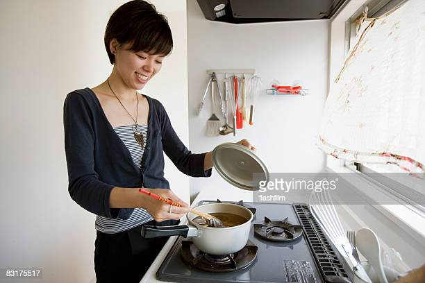 Japanese woman cooking, smiling