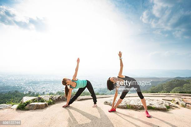 japanese woman doing yoga outdoors - holy city park stock pictures, royalty-free photos & images