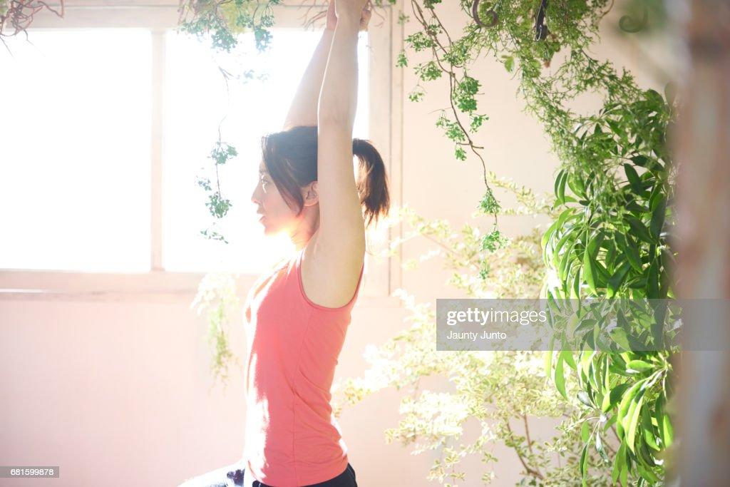 Japanese woman doing Yoga : Stock Photo