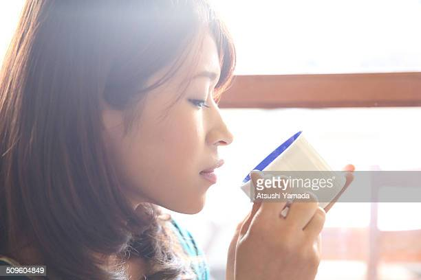 Japanese woman drinking coffee in cafe