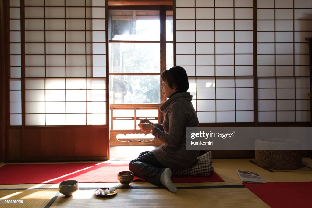 Japanese woman drinking matcha in traditional room : Stock Photo