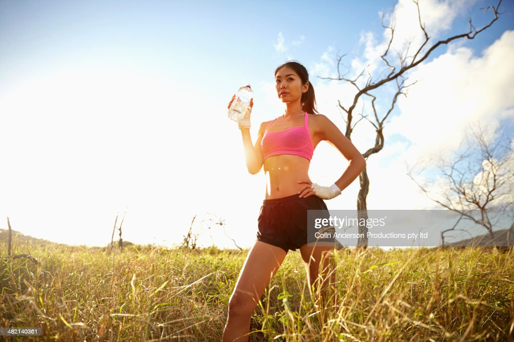 Japanese Woman Drinking Water In Rural Field Stock Photo