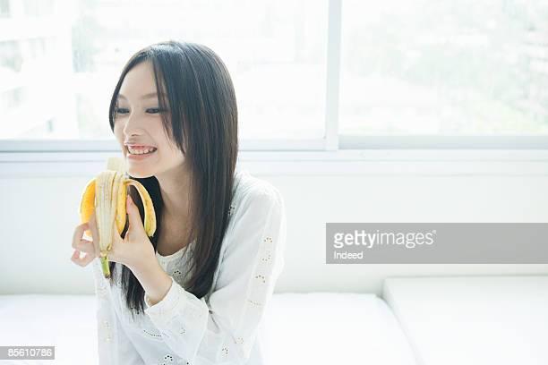 Japanese woman eating banana