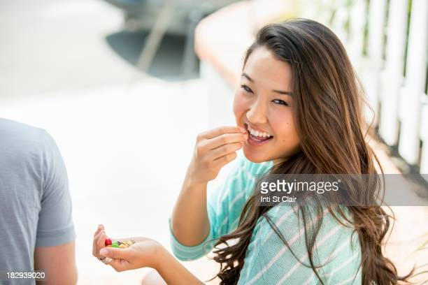 Japanese woman eating outdoors