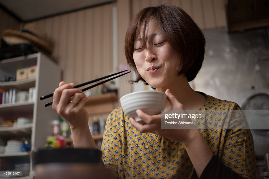 Japanese woman eating rice : Stock Photo