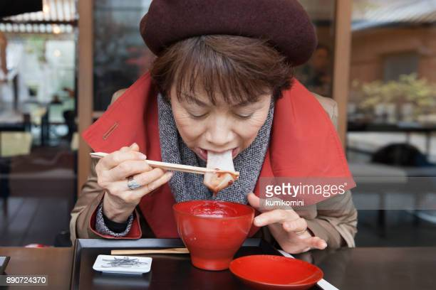 japanese woman enjoys japanese traditional sweets - mochi stock photos and pictures
