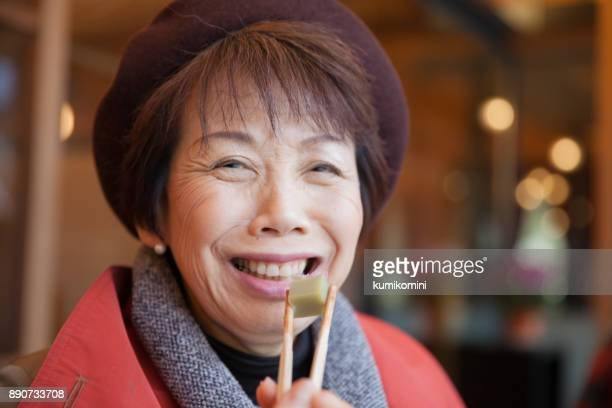 Japanese woman enjoys Japanese traditional sweets