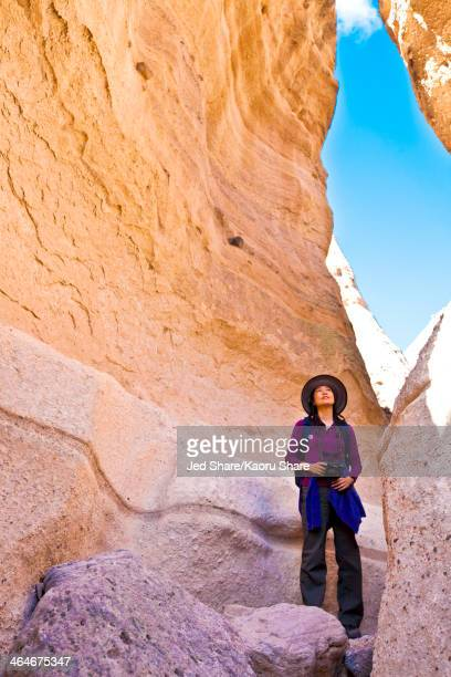 japanese woman exploring rock formations, santa fe, new mexico, united states - santa fe new mexico stock pictures, royalty-free photos & images