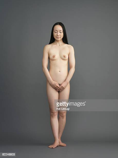 Japanese woman eyes closed, standing in nude
