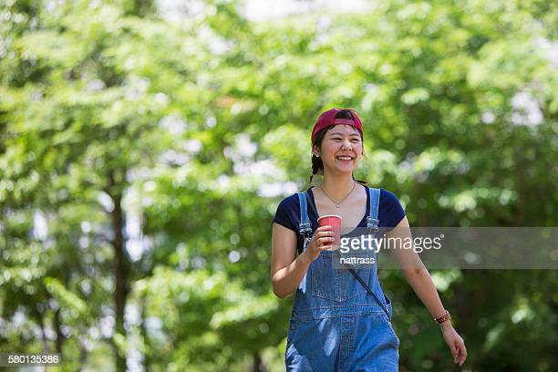 japanese woman having a coffee on the go - coffee drink stock pictures, royalty-free photos & images