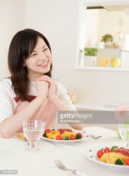 Japanese woman having lunch with smiling