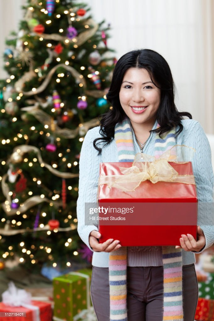 Japanese woman holding Christmas gifts : Stock Photo