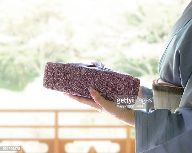 Japanese Woman Holding Gift