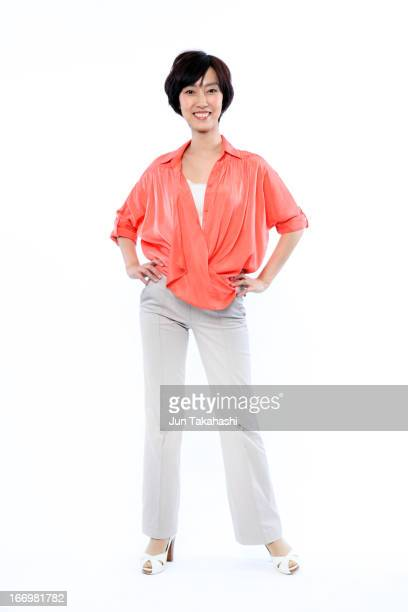 Japanese woman in front of white back ground.