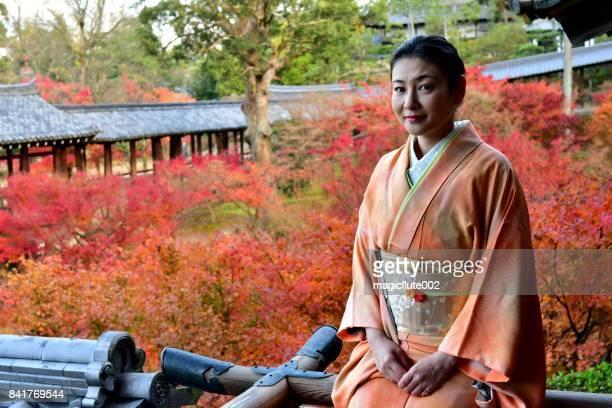 Japanese Woman in Kimono and Autumn Foliage at Tofuku-ji, Kyoto